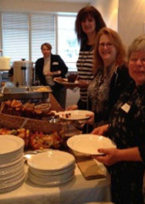 Attendees enjoying Women's AM breakfast